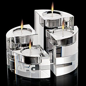 Thick Optical Crystal Candleholder set - Staggered heights makes this dazzling set a gift to remember.